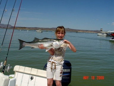 Fishing Guide, Gidget Moon Miller and her beautiful Striped Bass!